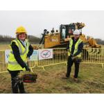 Councillor Carol Hart, Derbyshire County Council's Cabinet Member for Health and Communities, cuts the first sod at the council's new care home development in Cotmanhay, with project manager for Wates Construction Limited, Robert Stobo.