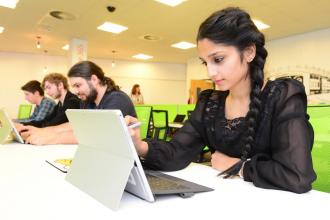 Students studying with laptops.